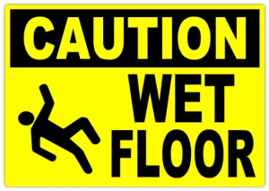 CAUTION WET FLOOR- AVOID PUDDLES
